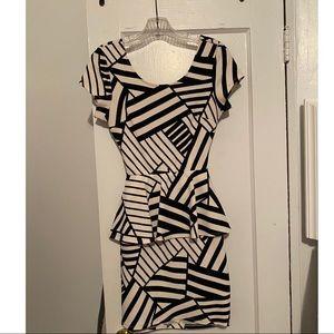 Black and white peplum mini dress